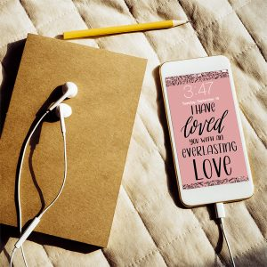 phone with lockscreen and journal on bed pexels Porapak Apichodilok | Lettering for Jesus wallpapers