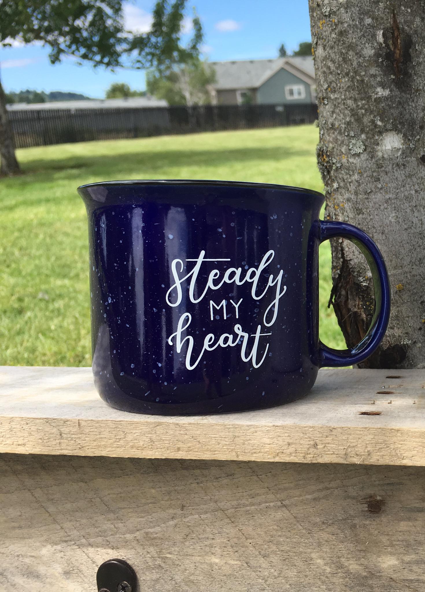 Cobalt Blue Steady My Heart Campfire Mug sitting on a handmade shelf by @piece.in.mind in a park