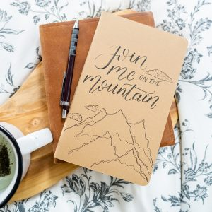 Join Me on the Mountain Journal and Be Still Mug during devotional time | by Lettering for Jesus | photo by The Modern Sojourner