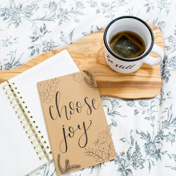 Choose Joy Journal and Be Still Mug during devotional time | by Lettering for Jesus | photo by The Modern Sojourner