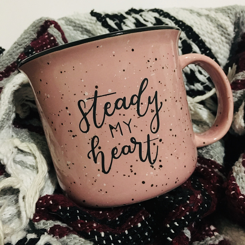 Pink Steady My Heart Campfire Mug on a blanket